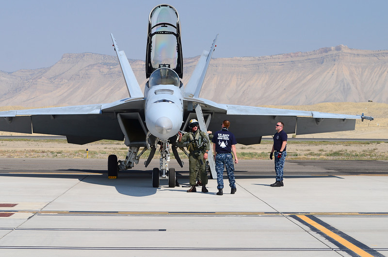 """LT Chris """"Grippy"""" Snyder and crew chiefs pre-flight's the VFA-106 F/A-18F prior to his and LT Daniel """"Trig"""" Osbourn's (his RIO/WSO) flight demo."""