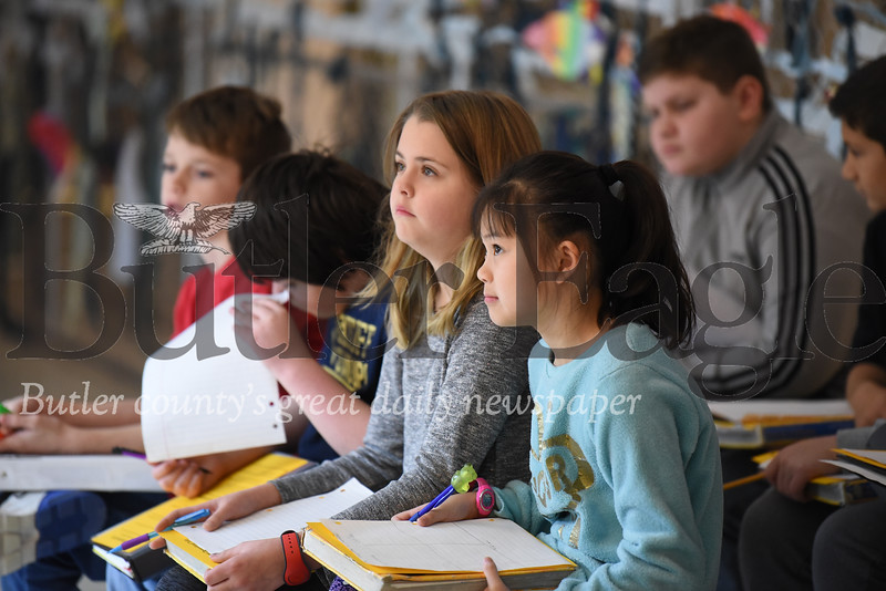 Students listen to lab instructions from Butler Middle School fifth grade science teacher Dave McCool. Seb Foltz/Butler Eagle