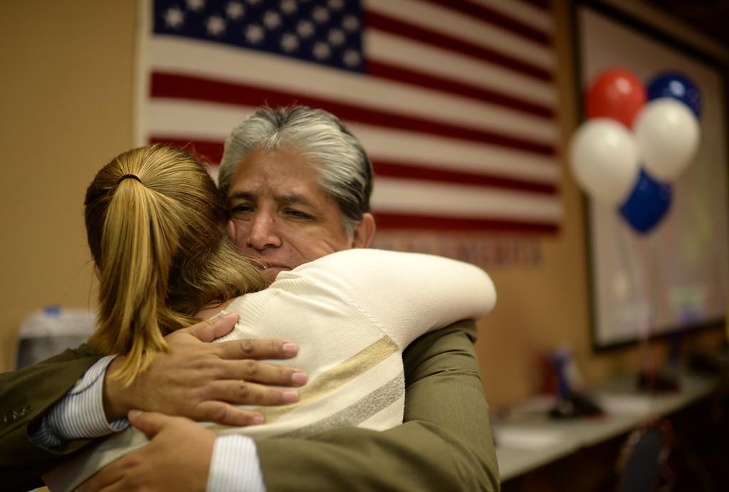 . COLORADO SPRINGS, CO - September 10 : Jayne Oakes, left, and Ron Palacioz celebrate Bernie Herpin\'s win at Colorado El Paso County Republican Party Headquarters. Colorado Springs, Colorado. September 10, 2013. (Photo by Hyoung Chang/The Denver Post)