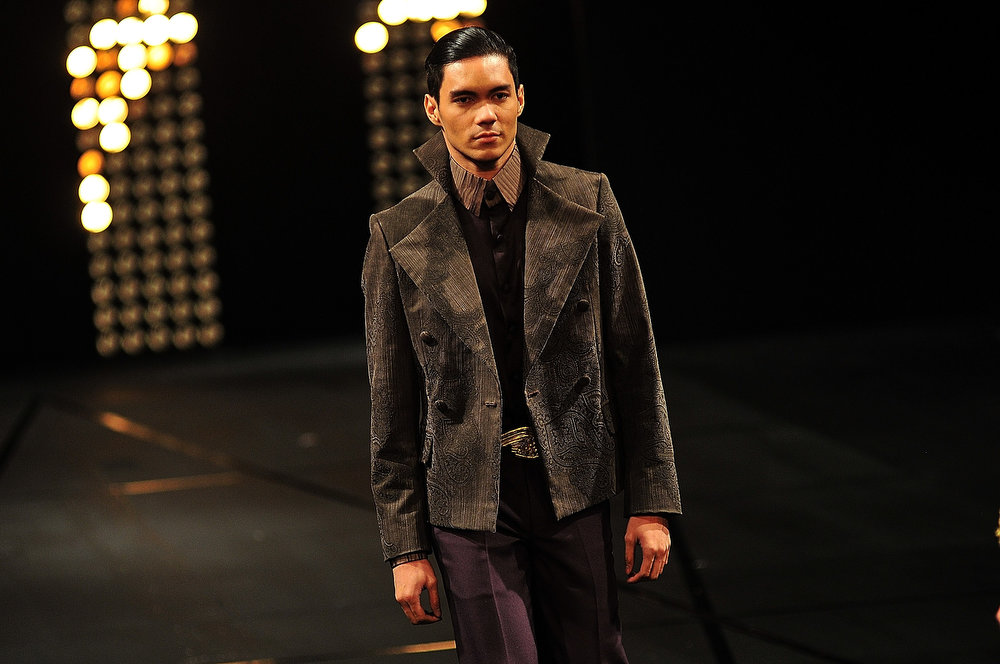 . A model showcases designs by Albert Andrada on the runway at the finale show during the last day of the 2013 Philippine Fashion Week Holiday at the SMX convention center in Pasay City on May 26, 2013 in Manila, Philippines.  (Photo by Veejay Villafranca/Getty Images)