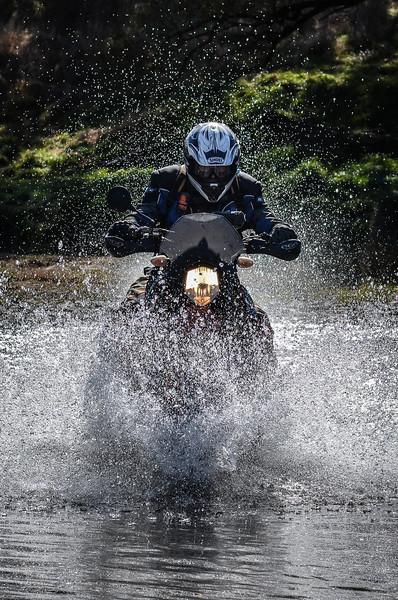 Tony Hartley crossing a creek near Walcha (Dirt Action magazine)