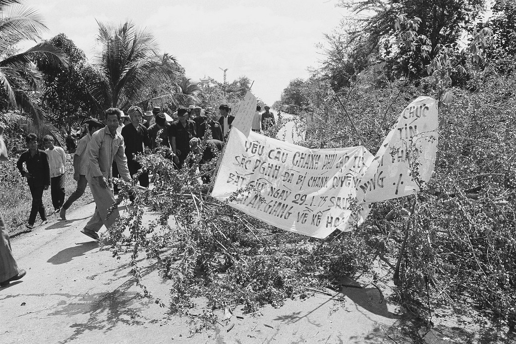 . Members of the Hoa Hao Buddhist sect block a road near Phong Phu, South Vietnam, about 90 miles southwest of Saigon, with tree branches, Saturday, Feb. 1, 1975. They were protesting a government order to disband the sect?s private army and the arrest of two of their leaders. (AP Photo)