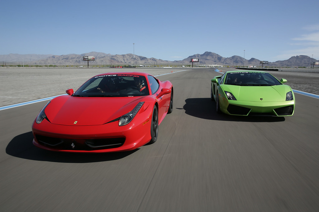 . When a Ferrari (left) takes on a Lamborghini, who wins? You can find out by driving one of them at Exotics Racing at the Las Vegas Motor Speedway. Provided by Exotics Racing