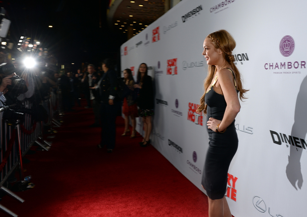 """. Actress Lindsay Lohan arrives for the premiere of Dimension Films\' \""""Scary Movie 5\"""" at ArcLight Cinemas Cinerama Dome on April 11, 2013 in Hollywood, California.  (Photo by Michael Buckner/Getty Images)"""