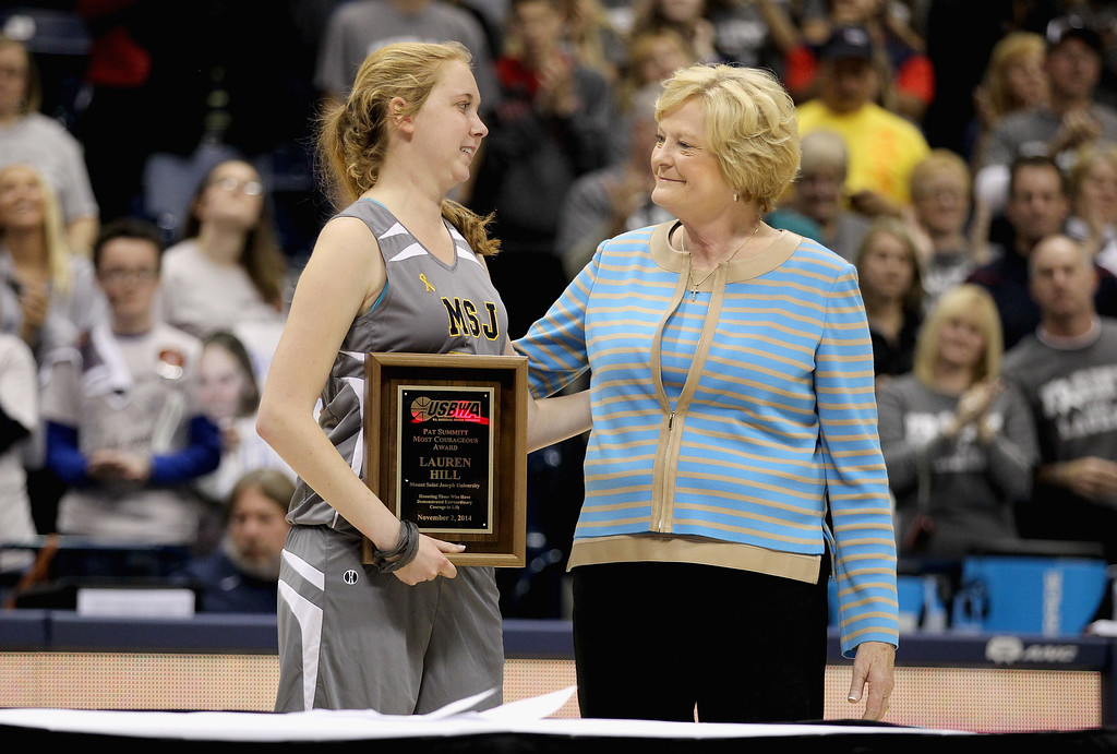 . Lauren Hill of Mount St. Joseph shares a hug with Pat Summitt during a halftime awards ceremony during the game against Hiram at Cintas Center on November 2, 2014 in Cincinnati, Ohio. Hill, a freshman, has terminal cancer and this game was granted a special waiver by the NCAA to start the season early so she could play in a game.  (Photo by Andy Lyons/Getty Images)