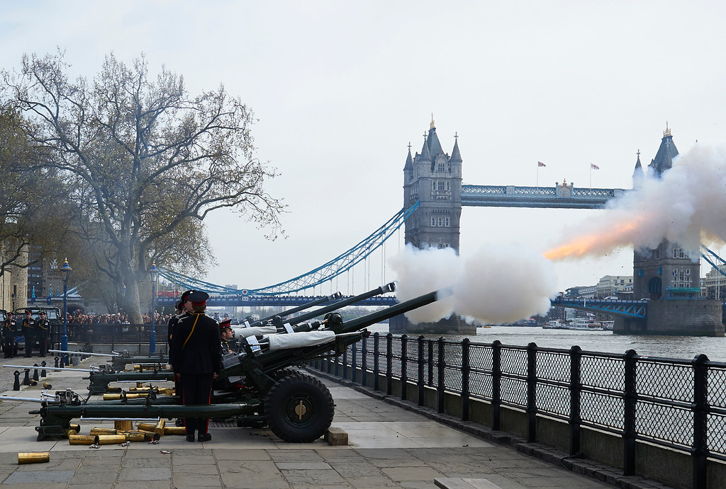 . The Honourable Artillery Company fire a 62 gun salute against a backdrop of London\'s Tower Bridge, on April 21, 2016, as Britain\'s Queen Elizabeth II celebrates her 90th birthday.  Britain celebrates Queen Elizabeth II\'s 90th birthday on Thursday, with her eldest son Prince Charles paying tribute in a special radio broadcast and Prime Minister David Cameron leading a parliamentary homage. / AFP PHOTO / NIKLAS HALLE\'N/AFP/Getty Images
