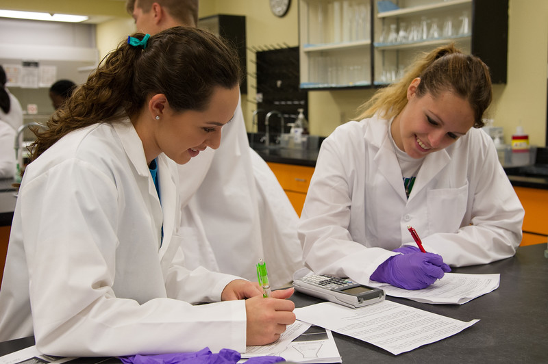 Students Allison Orta and Kaila Montogmery, work collaboratively on their collected data during their General Chemistry Lab.