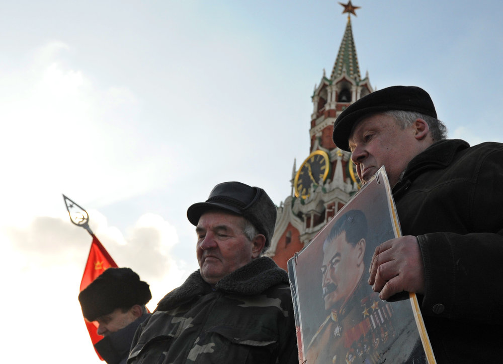 . Russian communists and their supporters carry a portrait of Soviet dictator Josef Stalin as they lay flowers at his tomb at the Red Square in Moscow on March 5, 2013. Russia marks today 60 years since the death of Stalin with attitudes split about whether to view him as a tyrant who slaughtered millions or a national savior who helped turn the country into a global superpower that emerged victorious in World War II.  ANDREY SMIRNOV/AFP/Getty Images