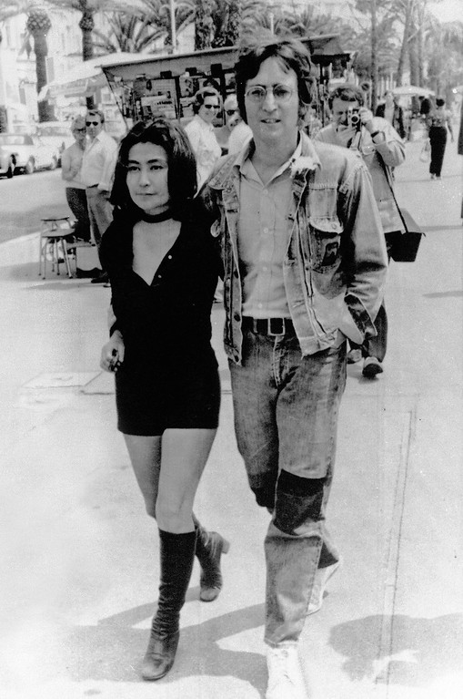 ". Musician John Lennon and his wife Yoko Ono walk on the Croisette in Cannes, May 5, 1971.  They are presenting their films ""Apothesis\"" and \"" The Fly\"" at the 25th Cannes International Film Festival.  (AP Photo/Michel Lipchitz)"