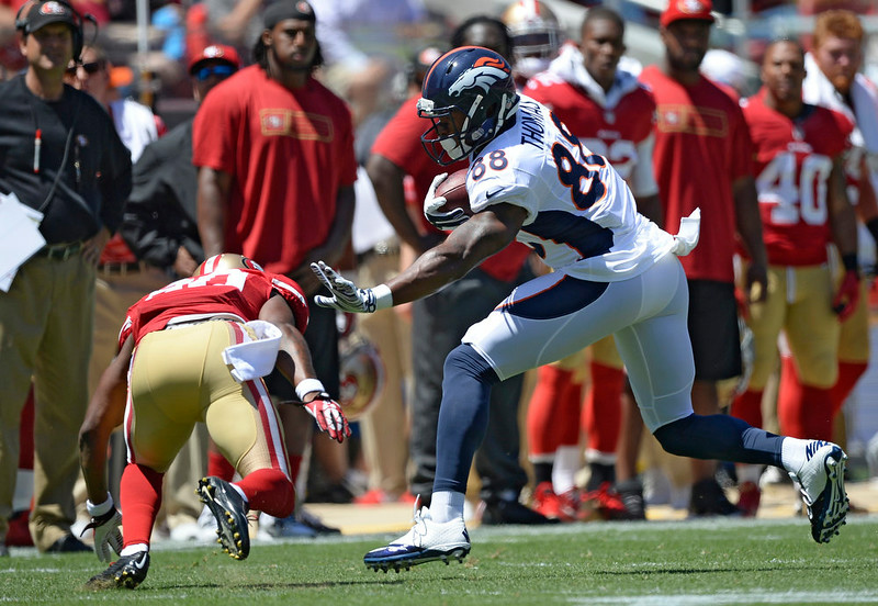 . Denver Broncos wide receiver Demaryius Thomas (88) stiff arms  San Francisco 49ers defensive back Perrish Cox (20) as he picks up a few yards during the first quarter August 17, 2014 at Levi\'s Stadium. (Photo by John Leyba/The Denver Post)