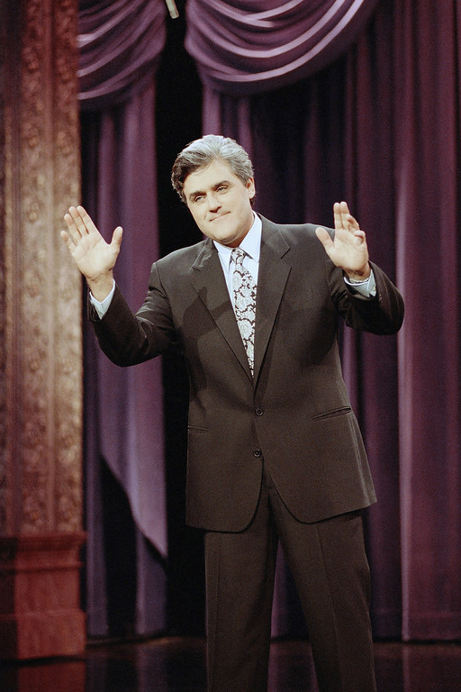 """. Jay Leno gestures during the opening monologue at the inauguration of \""""The Tonight Show with Jay Leno\"""" which was broadcast live on the east coast from NBC Studios in Burbank, Calif., May 25, 1992. The show features a new band with jazz musician Branford Marsalis as musical director. Leno\'s first guests were comedian Billy Crystal and singer Shanice. (AP Photo/Craig Fujii)"""
