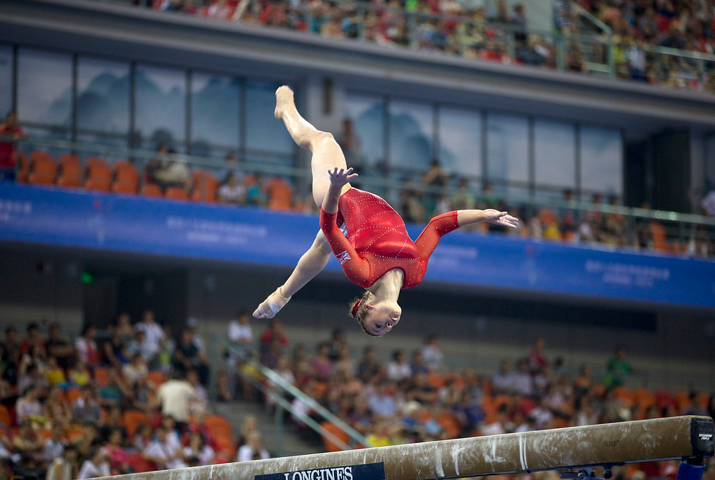 . Ruby Harrold of Britain performs on the balance beam during the women\'s qualifying round of the Artistic Gymnastics World Championships at the Guangxi Gymnasium in Nanning, capital of southwest China\'s Guangxi Zhuang Autonomous Region Monday, Oct. 6, 2014. (AP Photo/Andy Wong)