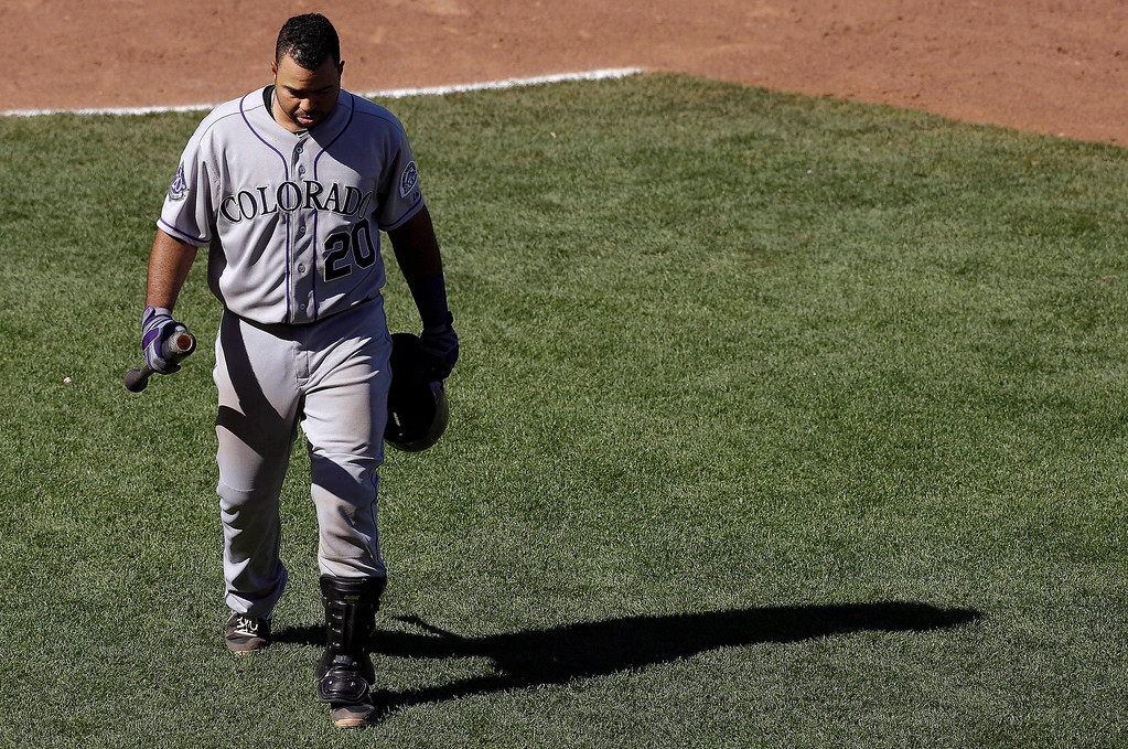 . Colorado Rockies\' Wilin Rosario (20) walks to the dugout after striking out against San Francisco Giants pitcher Chad Gaudin during the ninth inning of a baseball game in San Francisco, Wednesday, April 10, 2013. The Giants won 10-0. (AP Photo/Jeff Chiu)