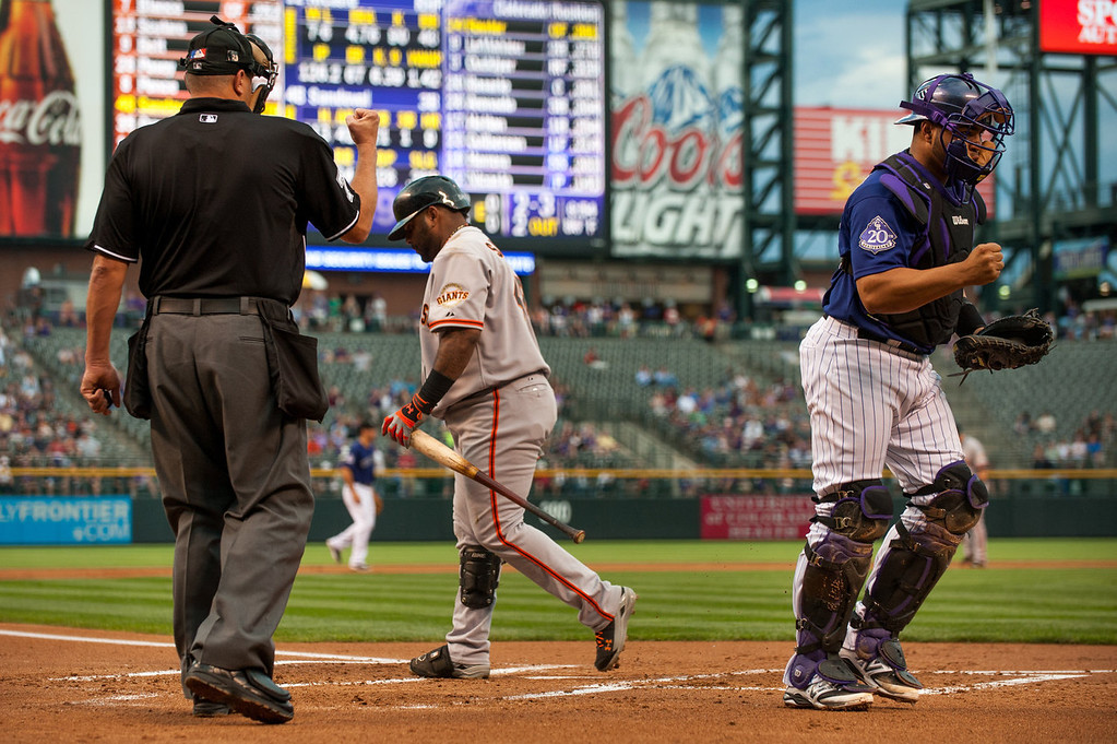 . Wilin Rosario #20 of the Colorado Rockies pumps his fist to celebrate a bases loaded strikeout of Pablo Sandoval #48 of the San Francisco Giants as called by home plate umpire Chad Fairchild during the first inning of a game at Coors Field on August 26, 2013 in Denver, Colorado. (Photo by Dustin Bradford/Getty Images)