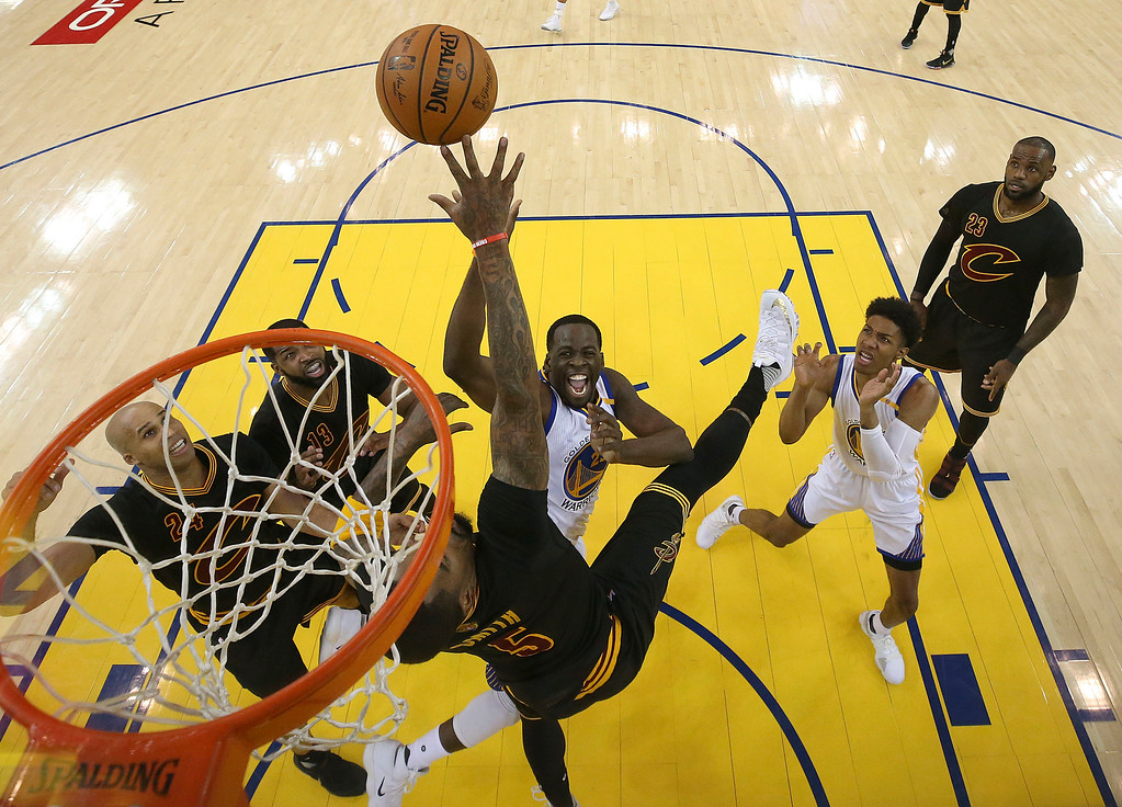 . Golden State Warriors forward Draymond Green, center, shoots against the Cleveland Cavaliers during the first half of Game 5 of basketball\'s NBA Finals in Oakland, Calif., Monday, June 12, 2017. (Ezra Shaw/Pool Photo via AP)