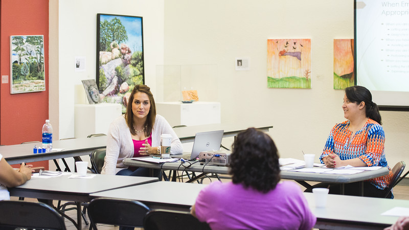 Brandalyn Duda (left) and Alejandra Camacho, counseling students from TAMU-CC host a parenting skills workshop  in the Antonio E. Garcia Arts & Education Center .