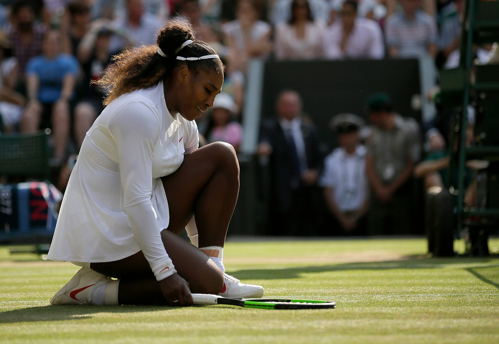 . Serena Williams of the United States kneels after losing a point to Germany\'s Angelique Kerber during their women\'s singles final match at the Wimbledon Tennis Championships, in London, Saturday July 14, 2018.(AP Photo/Tim Ireland)