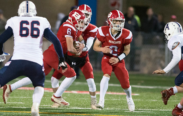 11/01/19 Wesley Bunnell | StaffrrBerlin football vs Avon on Friday night at Sage Park. Justn Skates (8) hands off to Johnny McGeever (6) while Jamie Palmese (2)