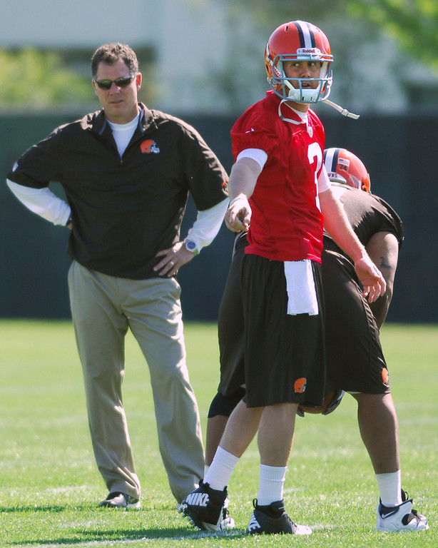 . News-Herald file Browns head coach Pat Shurmur looks on as Brandon Weeden talks things over with running back Trent Richardson, not pictured, during minicamp on Friday in Berea. The center is Jarrod Shaw.