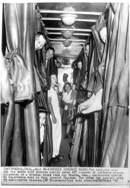 """Evacuees Homeward Bound"" -- caption on photograph"