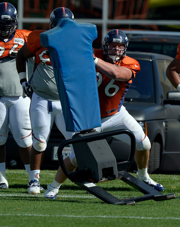 . Denver Broncos DT Mitch Unrein (96) hits the sled during training camp August 6, 2013 at Dove Valley. (Photo By John Leyba/The Denver Post)