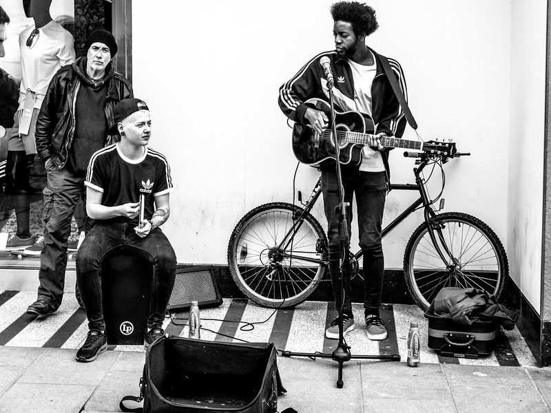 Two Buskers and an Interloper