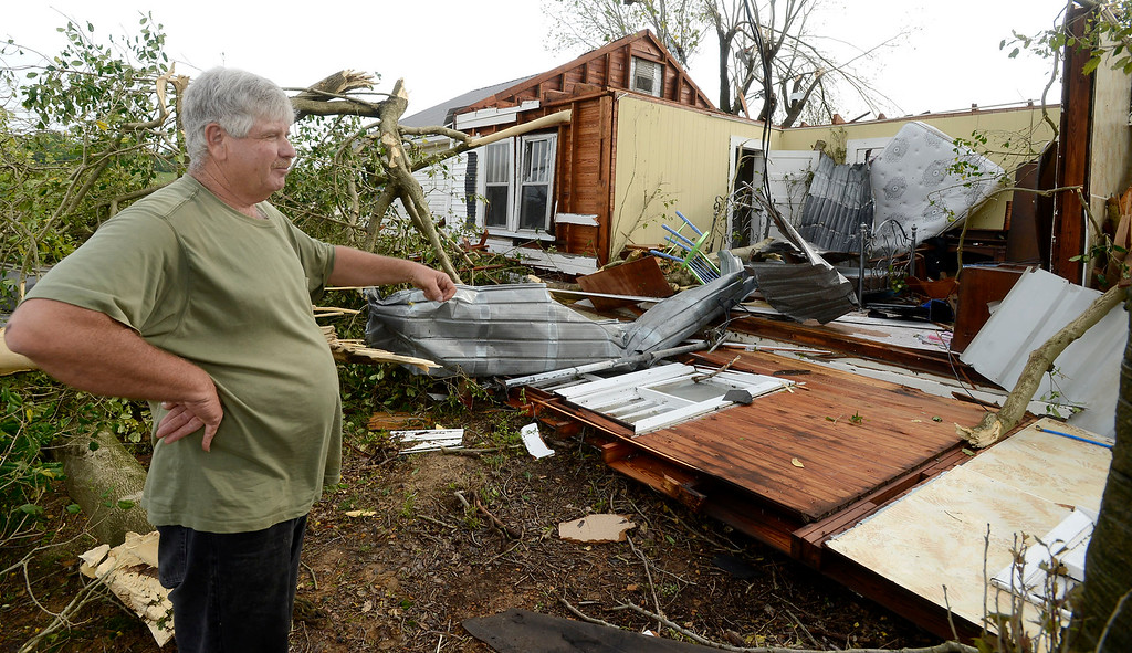 . Dennis Nix stands outside his father\'s destroyed house in the Straight Mountain community of Blount County, Ala., Tuesday, April 29, 2014.  Nix and his father were inside when a possible tornado struck but they were not injured.   (AP Photo/ AL.com, Mark Almond)