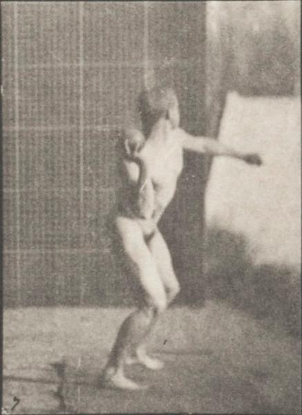 Nude man putting the shot