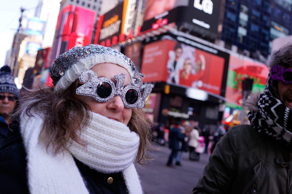 . NEW YORK, NY - DECEMBER 31: Revellers wait in Times Square on December 31, 2014 in New York City. An estimated one million people from around the world are expected to pack into Times Square to ring in 2015. (Photo by Spencer Platt/Getty Images)