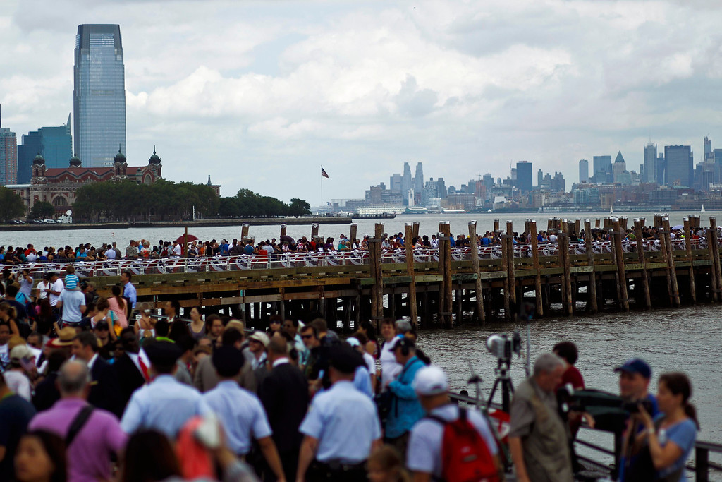 . People arrive at the Statue of Liberty and Liberty Island during its reopening to the public in New York July 4, 2013. Under steamy summer skies, tourists in New York flocked to ferries headed for the Statue of Liberty, re-opening with an Independence Day ceremony after closing in October as Superstorm Sandy approached. REUTERS/Eduardo Munoz