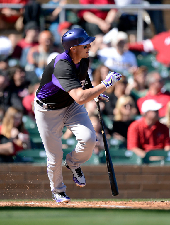 . SCOTTSDALE, AZ. - FEBRUARY 23: Troy Tulowitzki (2) of the Colorado Rockies in his first game back since May 30th gets a single against the Arizona Diamondbacks February 23, 2013 in Scottsdale. (Photo By John Leyba/The Denver Post)