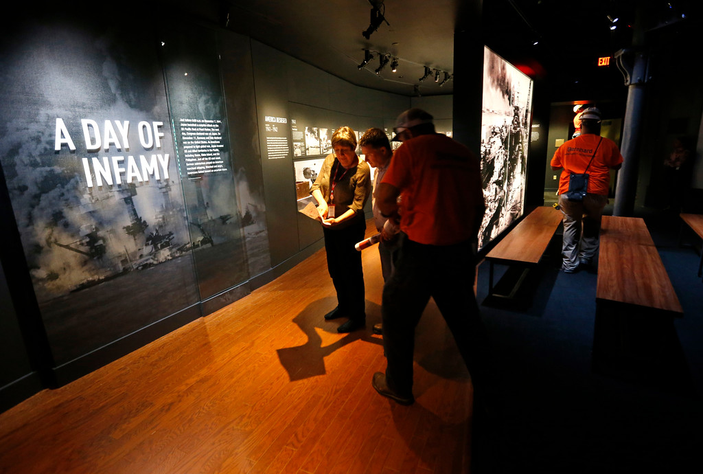 ". Workers go over the final installation of the permanent exhibit ""Salute to the Home Front\"" at the National World War II Museum which will open to the public this Saturday, in New Orleans, Monday, June 5, 2017. The exhibit tells the home front story from the 1920s to the development of the atomic bomb. (AP Photo/Gerald Herbert)"