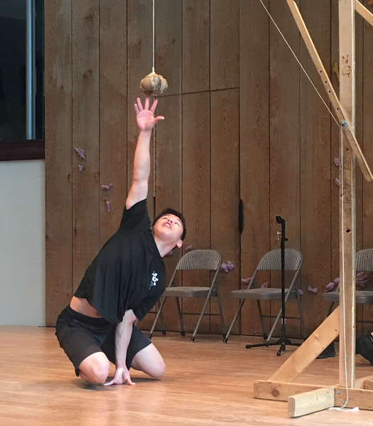 Alaskan Indian sport: balance on one hand and see how high you can reach with the other hand. This demanding activity lends itself to inside competition during harsh winters.