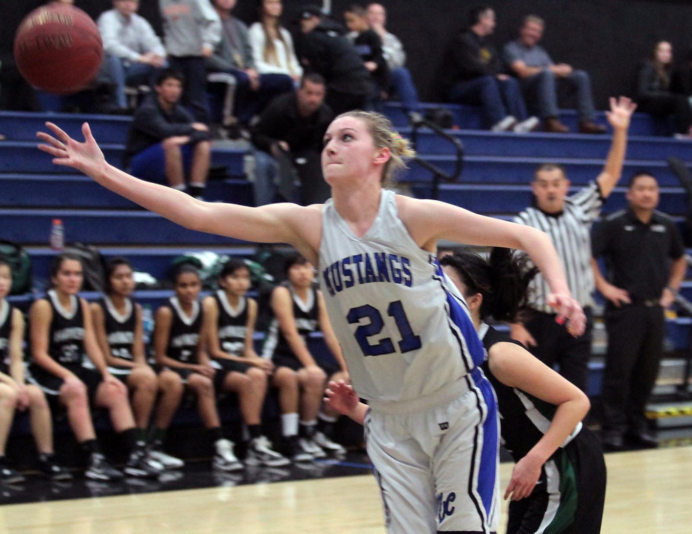 """. Monte Vista Christian 6\'3\"""" center Sydney Beadle lunges to grab a rebound for the Mustangs on Thursday, Feb. 21, 2013. MVC won the second-round Central Coast Section Division IV girls basketball game 53-36 in Watsonville, Calif. (Shmuel Thaler/Sentinel)"""
