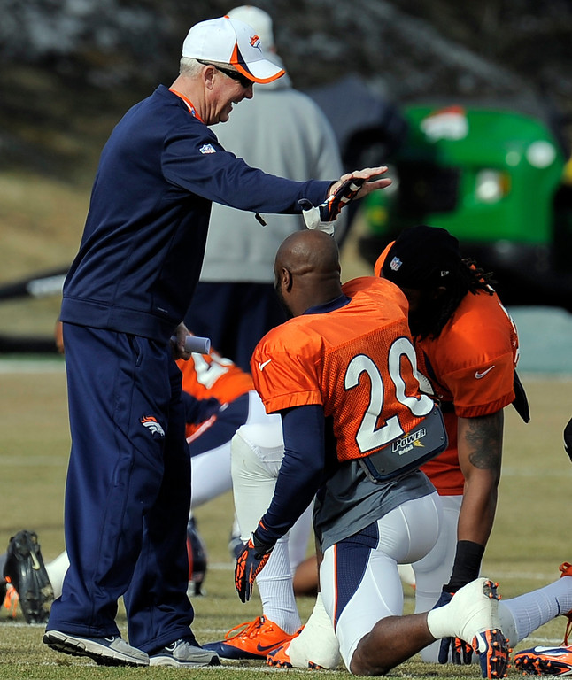 . Denver Broncos head coach John Fox high fives Michael Adams (20) before practice December 18, 2013 at Dove Valley (Photo by John Leyba/The Denver Post)