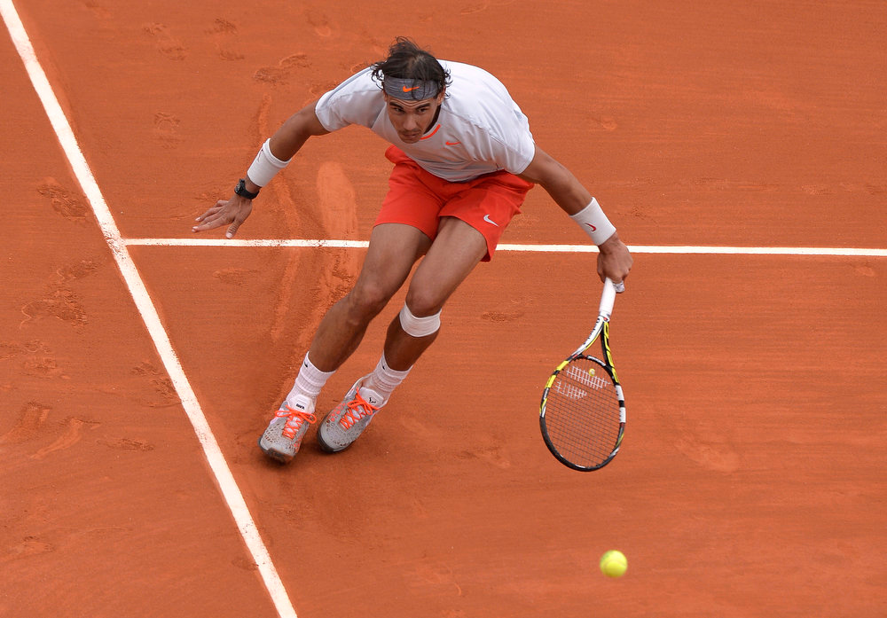. Spain\'s Rafael Nadal returns to Germany\'s Daniel Brands during their French Tennis Open first round match at the Roland Garros stadium in Paris, on May 27,  2013. MIGUEL MEDINA/AFP/Getty Images