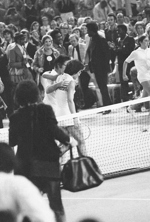 """. Mrs. Billie Jean King consoles Bobby Riggs after she defeated him in straight sets at the Houston Astrodome in \""""The Battle of the Sexes\"""" tennis match on Sept. 20, 1973. (AP Photo)"""