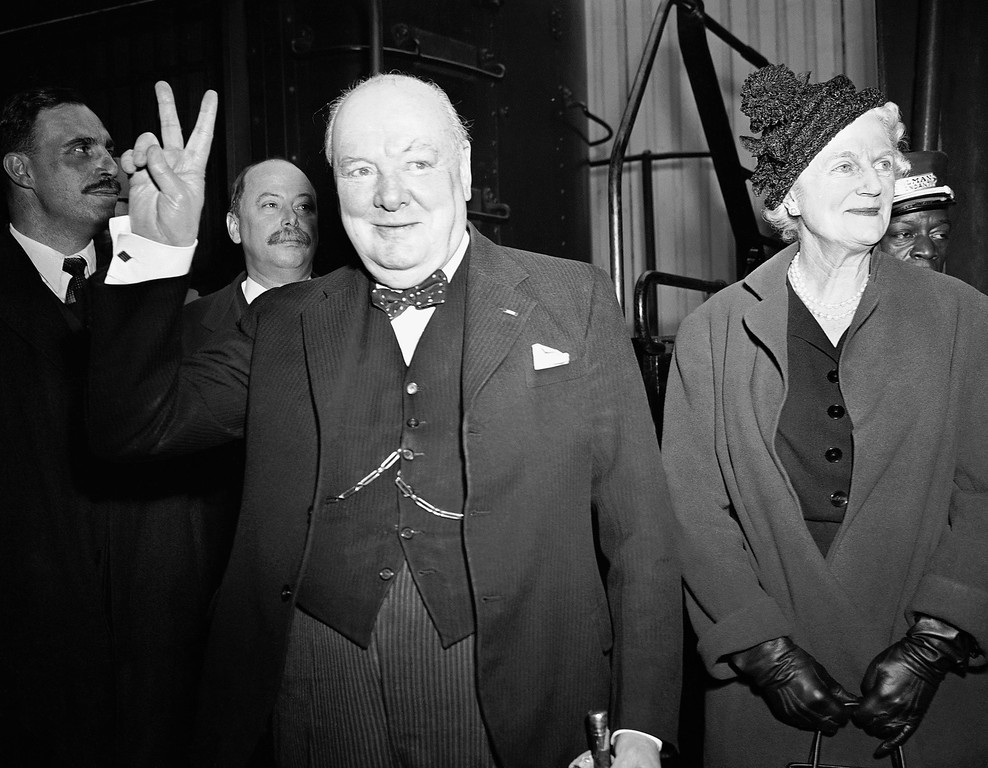 ". 1949: Winston Churchill. Winston Churchill gives his famous ""V\"" sign upon arrival at Union Station, March 24, 1949 in Washington. With him is his wife Clementine. (AP Photo)"