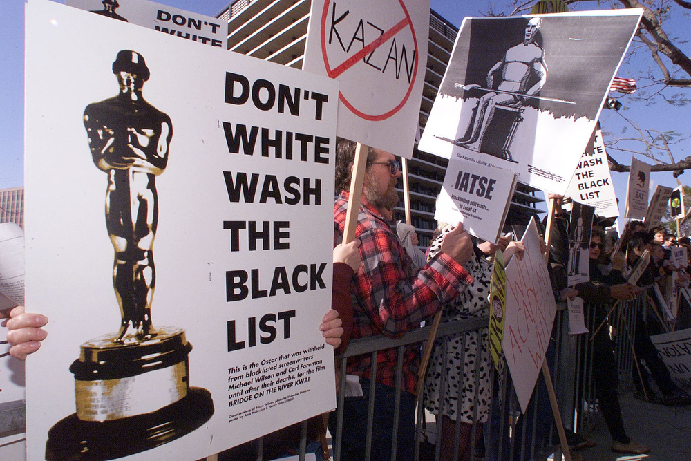 ". Protestors demonstrate 21 March 1999 in Los Angeles against the Lifetime Achievement Award to be presented to US film director Elia Kazan during the 71st Annual Academy Awards. The award to Kazan, who directed ""On the Waterfront\"", has angered many stars who recall how he destroyed careers when he \""named names\"" before the US House Un-American Activities Committee\'s infamous 1950\'s probe of communists in Hollywood.  HECTOR MATA/AFP/Getty Images"