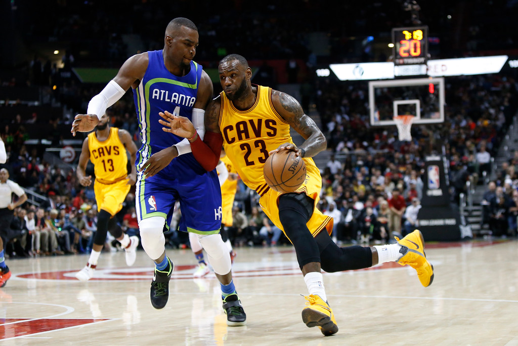 . Cleveland Cavaliers forward LeBron James (23) drives to the basket against Atlanta Hawks forward Paul Millsap (4) in the second half of an NBA basketball game, Friday, March 3, 2017, in Atlanta. The Cavaliers won 135-130. (AP Photo/Brett Davis)