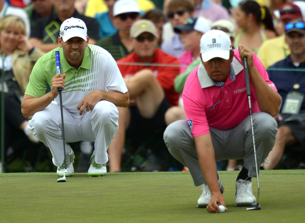 Description of . Sergio Garcia of Spain and Bo Van Pelt of the US line up their putts during the final round of the 77th Masters golf tournament at Augusta National Golf Club on April 14, 2013 in Augusta, Georgia.  JIM WATSON/AFP/Getty Images