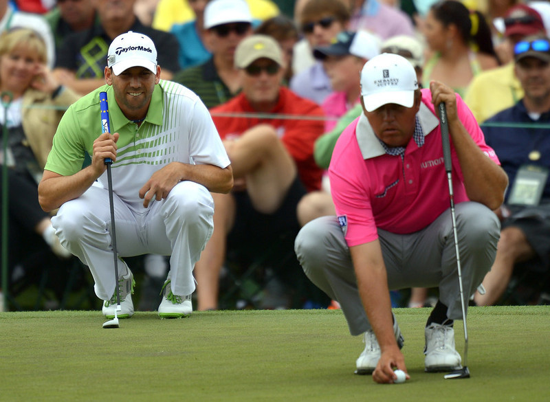 . Sergio Garcia of Spain and Bo Van Pelt of the US line up their putts during the final round of the 77th Masters golf tournament at Augusta National Golf Club on April 14, 2013 in Augusta, Georgia.  JIM WATSON/AFP/Getty Images