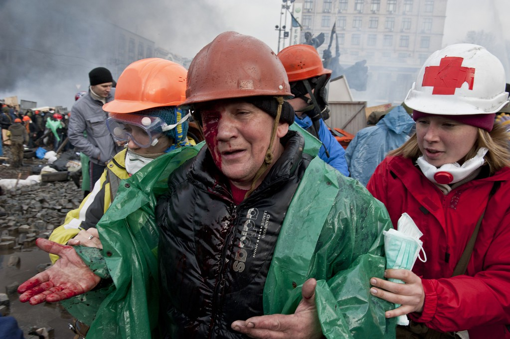 . A wounded anti-government protester is evacuated during clashes with riot police on Kiev\'s Independence square on February 19, 2014.  AFP PHOTO / PIERO  QUARANTA/AFP/Getty Images