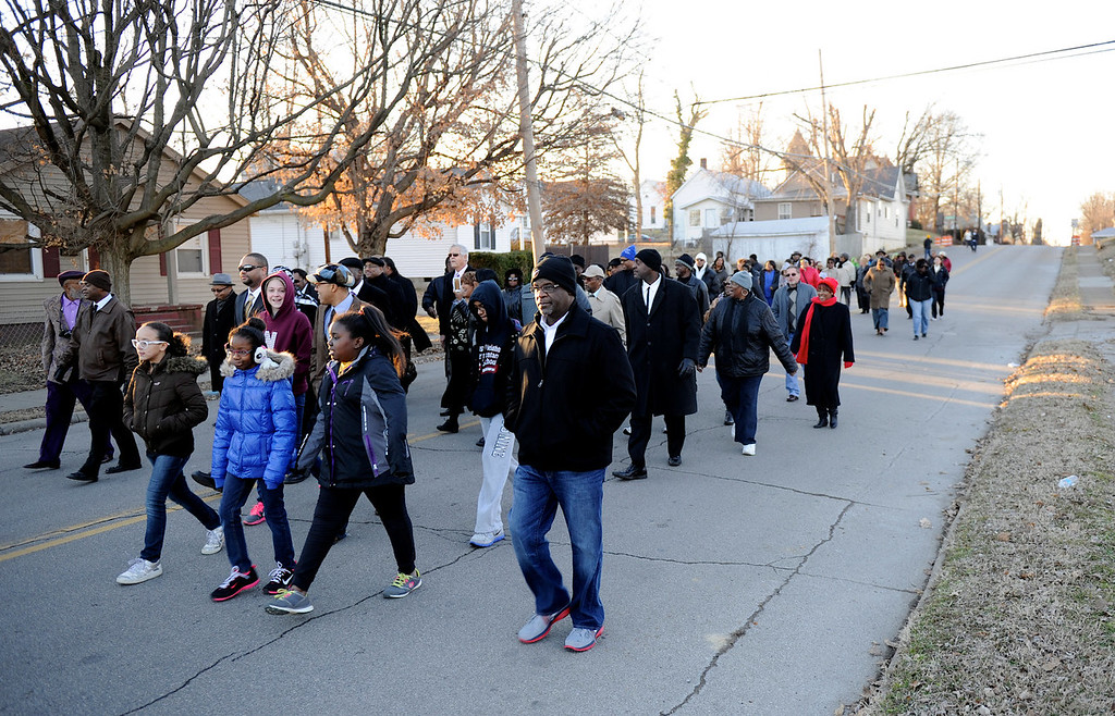 . People march down Washington Street towards Greater Norris Chapel Baptist Church during the Henderson County Black History Committee\'s Celebration of Dr. Martin Luther King, Jr\'s birthday in Henderson, Ky. Sunday Jan. 19, 2014. (AP Photo/The Gleaner, Darrin Phegley)