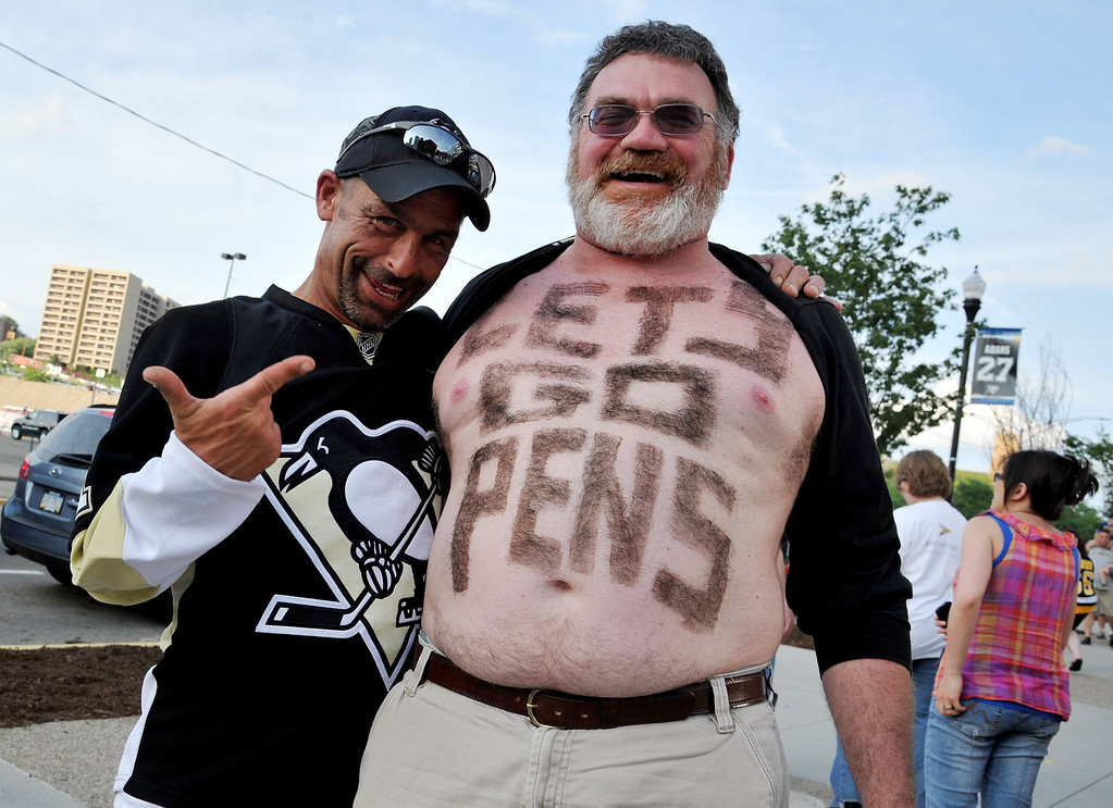 . PITTSBURGH, PA - JUNE 01:  Fans stand outside the Consol Energy Center prior to Game One of the Eastern Conference Final of the 2013 NHL Stanley Cup Playoffs on June 1, 2013 in Pittsburgh, Pennsylvania.  (Photo by Jamie Sabau/Getty Images)