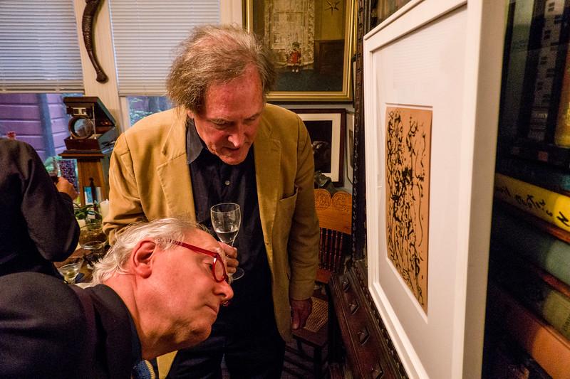 Martin Muller looking at front of Jackson Pollock silk screen print acquired by Robert Flynn Johnson