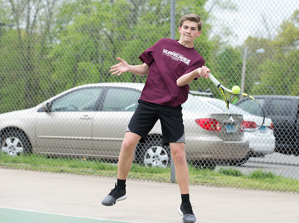 05/09/19 Wesley Bunnell | Staff Newington boys tennis defeated New Britain at New Britain High School on Thursday afternoon. New Britain's Seagan Foster competes in the number one match.