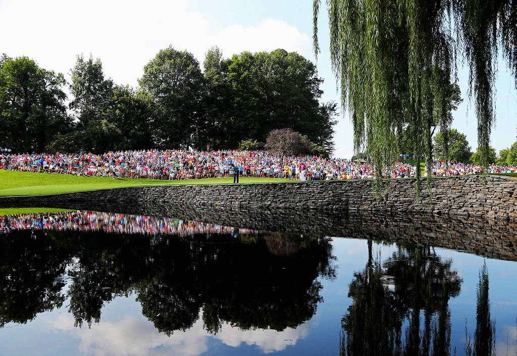 . ROCHESTER, NY - AUGUST 08:  Fans watch the play of the Tiger Woods, Keegan Bradley and Davis Love III group on the 15th green during the first round of the 95th PGA Championship on August 8, 2013 in Rochester, New York.  (Photo by Rob Carr/Getty Images)