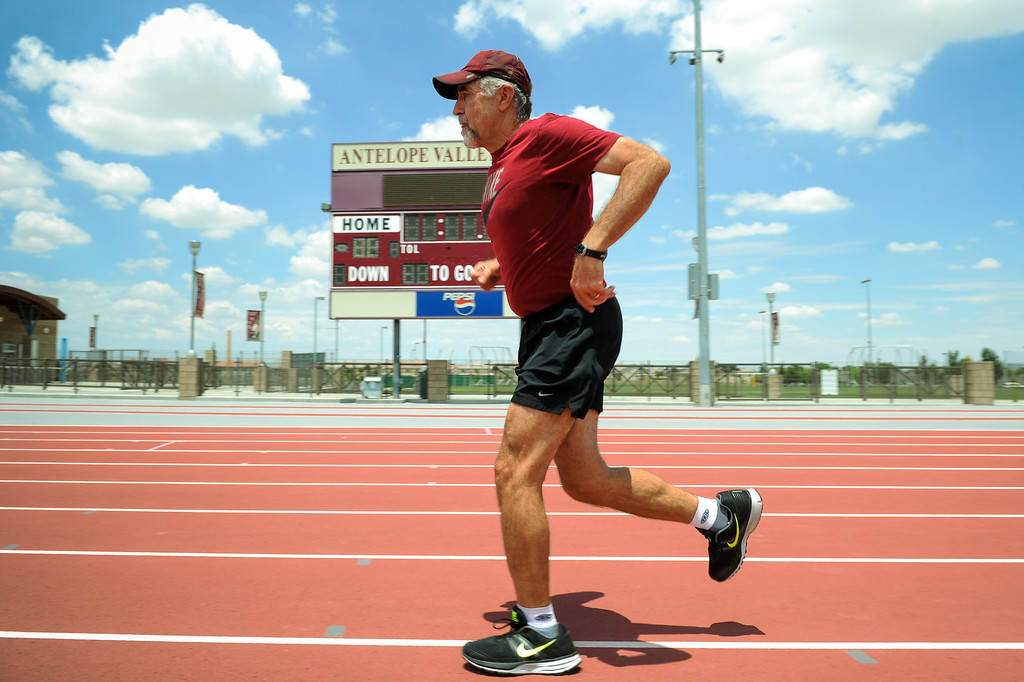 . Mark Covert runs at Antelope Valley College, Monday, July 22, 2013.  Covert is the U.S. record holder and No. 2 in the world for the longest streak of consecutive days having run at least 1 mile. Covert will end the streak Tuesday, July 23, at Antelope Valley College on the 45th anniversary of when it started. (Michael Owen Baker/L.A. Daily News)