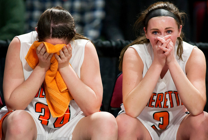 BANGOR, Maine -- 03/04/2017 -- Shead's Katelyn Mitchell (left) and Shead's Holly Preston sit dejected after being defeated by Vinalhaven during their Class D girls basketball state championship at the Cross Insurance Center in Bangor Saturday. Ashley L. Conti | BDN